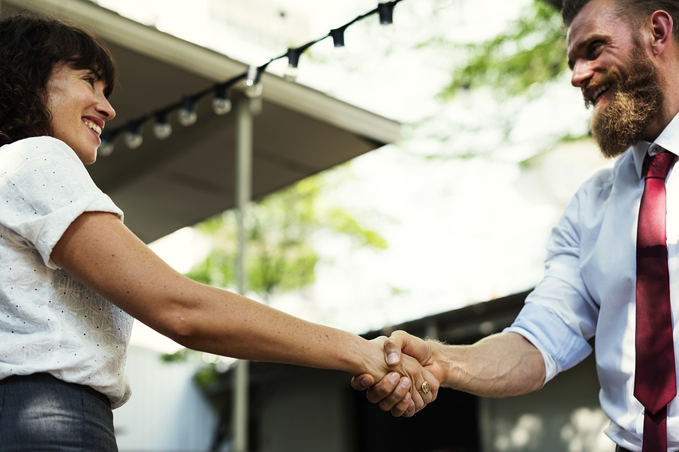 Advisor and client shaking hands