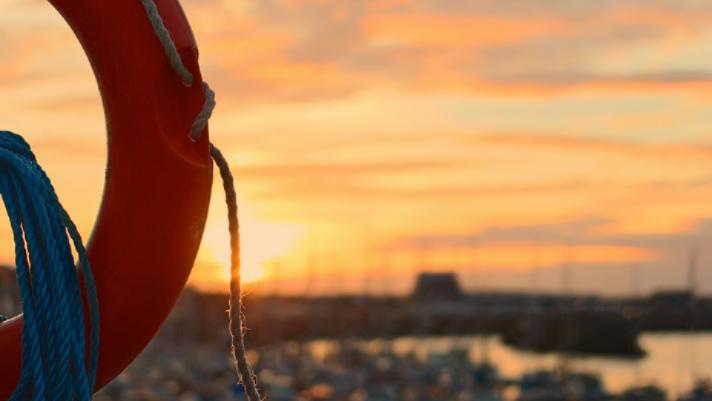 life saving buoy with marina in background