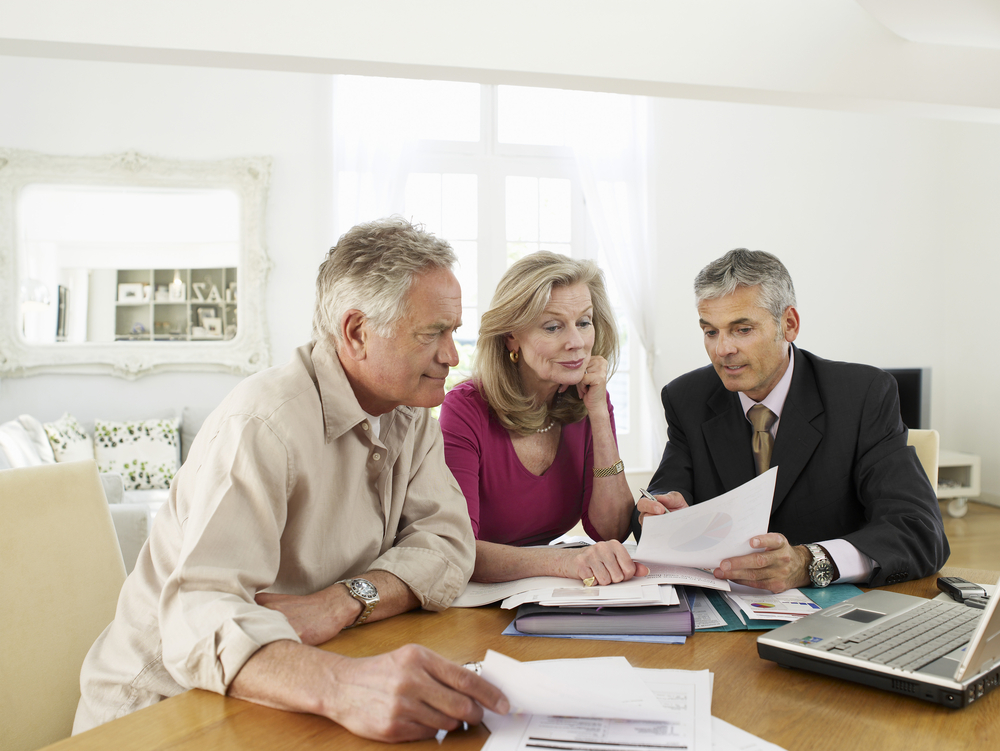 financial advisor explaining financial independence to clients