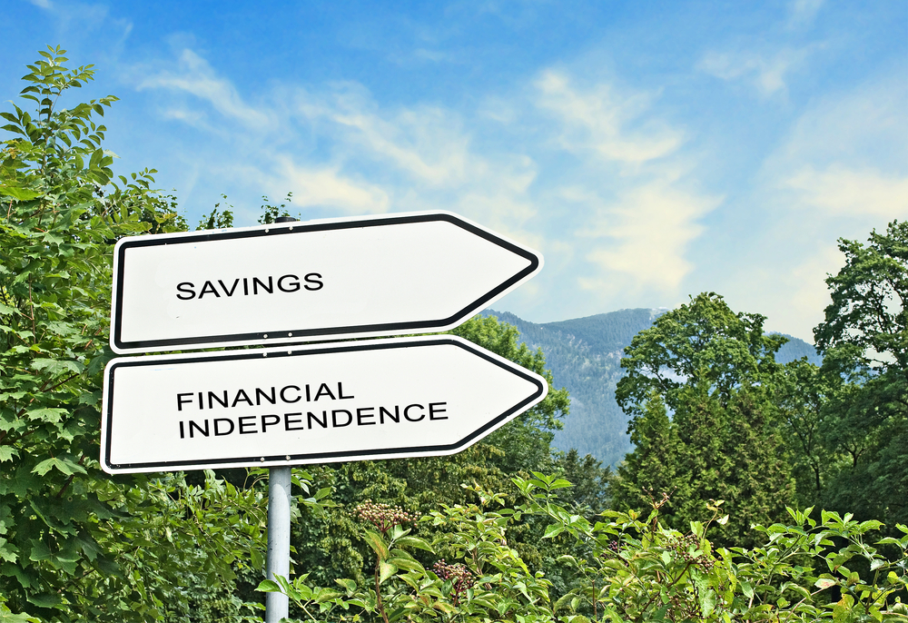 signs pointing to savings and financial independence outside
