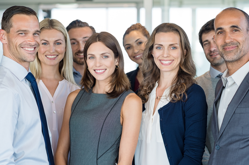 business team members posing for an office photo