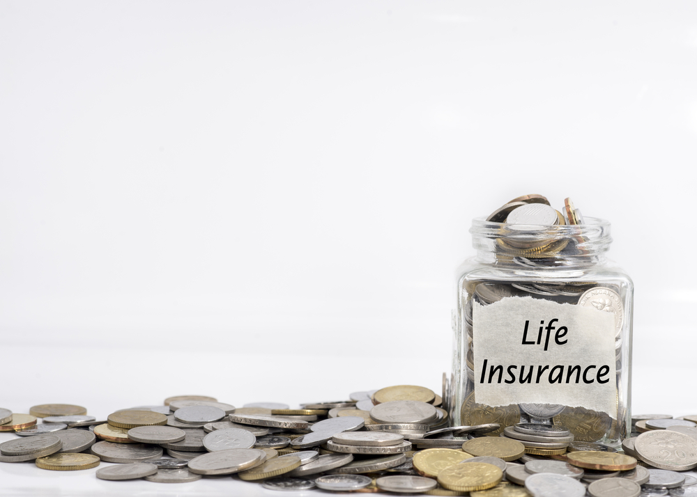 coins in a jar named life insurance