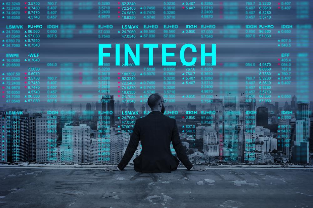 fintech image - man overlooking city