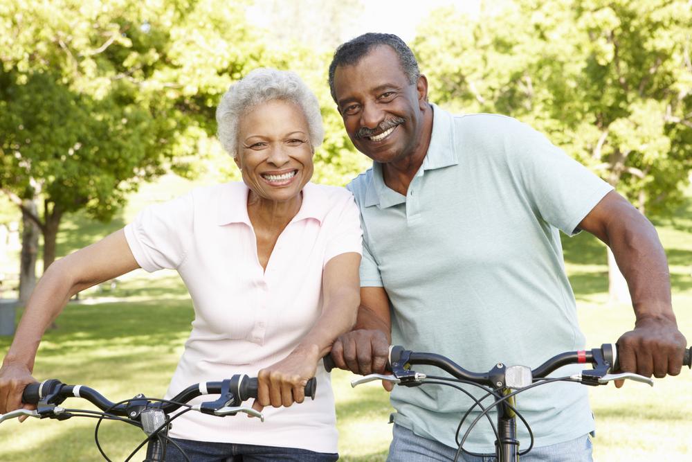 senior couple enjoying a bike ride