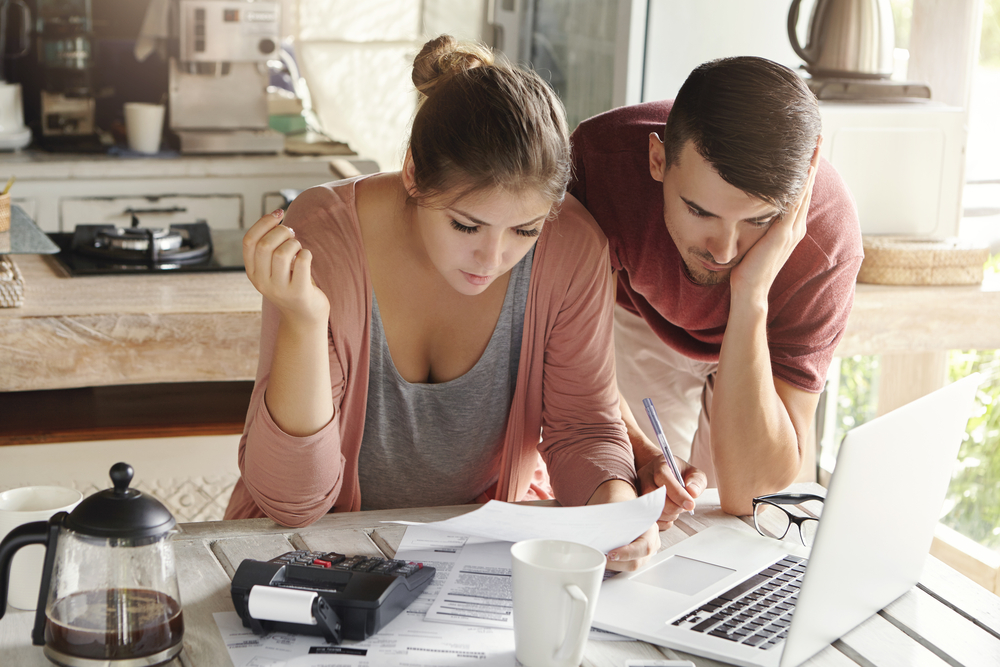 young couple looking over their finances and annuity options