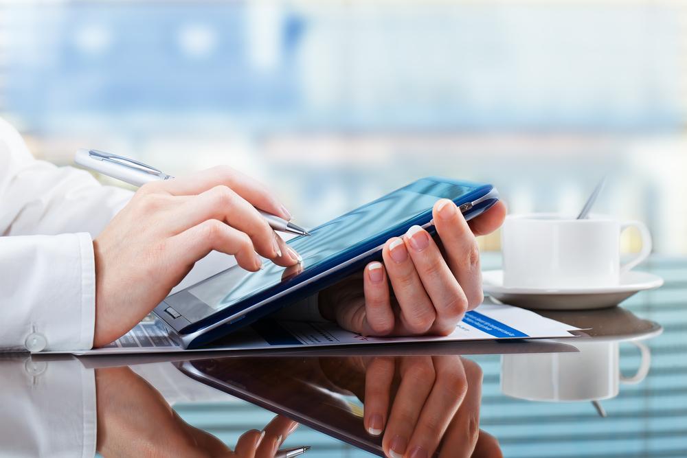 financial advisor using a tablet