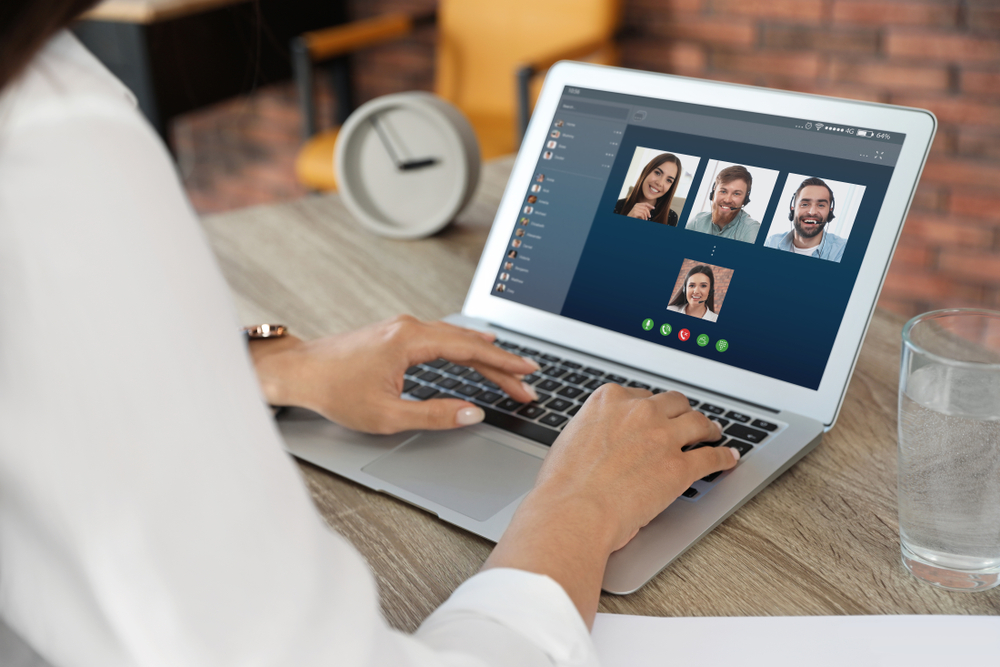 financial advisor video chatting with her employees