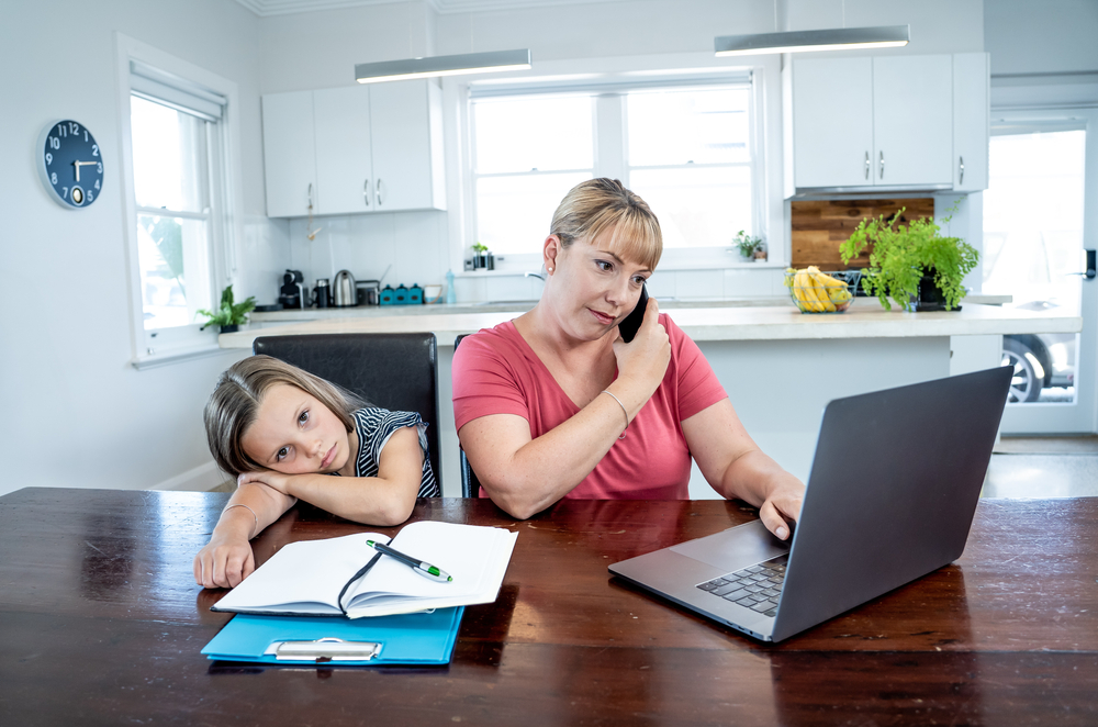 financial firm employee working from home with child out of school