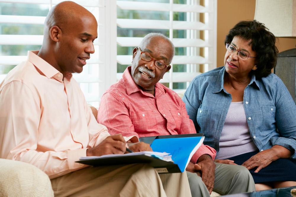 financial advisor explaining asset based long term care to clients